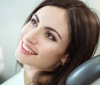 Image of a Young woman sitting on the dentist chair